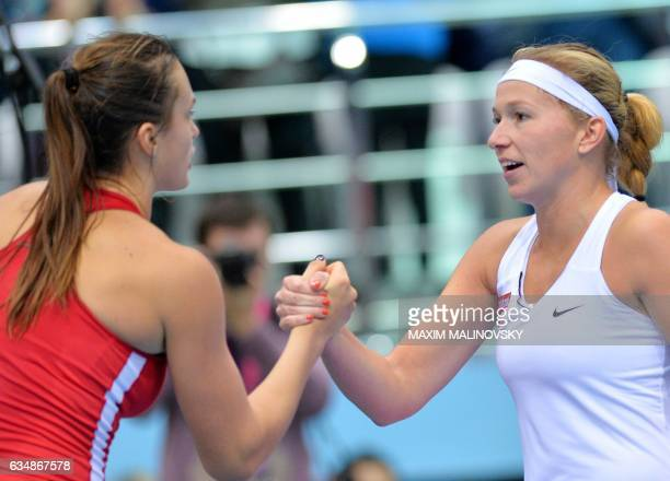 Dutch Michaella Krajicek shakes hand with Aryna Sabalenka of Belarus after the Fed Cup World Group first round tennis match between Belarus and...
