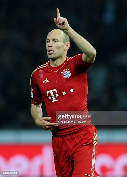 Dutch midfielder Arjen Robben celebrates during the German first football division Bundesliga match between Hertha BSC Berlin and FC Bayern Munich in...