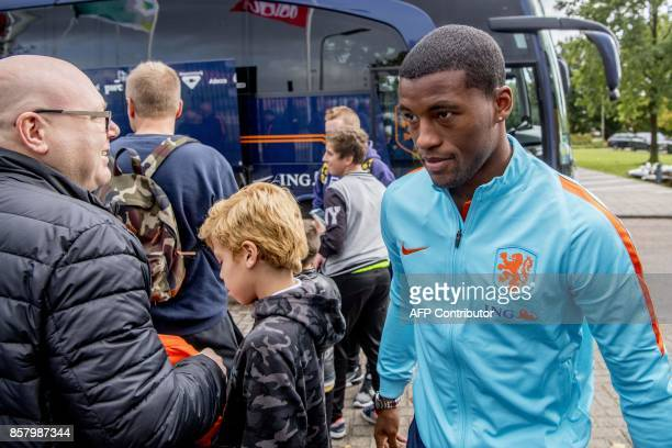 Dutch midfielder Georginio Wijnaldum arrives with the Dutch National football team for a closed training session in Amsterdam on October 5 ahead of...