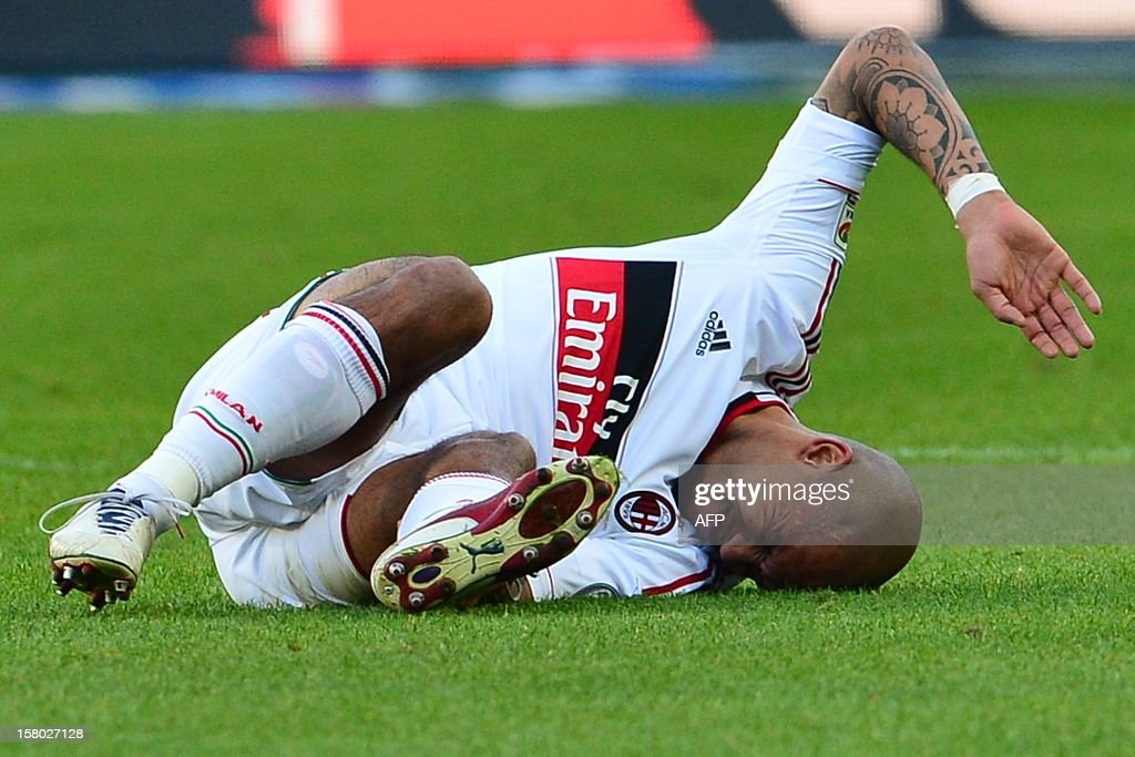 Dutch midfielder Nigel De Jong reacts in pain on the pitch as he suffers a ruptured Achilles tendon injury that will rule him out for the rest of the season during the Italian Serie A football match between Torino and AC Milan at the Olympic Stadium in Turin on December 9, 2012. AFP PHOTO / GIUSEPPE CACACE