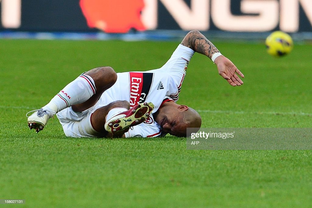 Dutch midfielder Nigel De Jong reacts in pain on the pitch as he suffers a ruptured Achilles tendon injury that will rule him out for the rest of the season during the Italian Serie A football match between Torino and AC Milan at the Olympic Stadium in Turin on December 9, 2012.