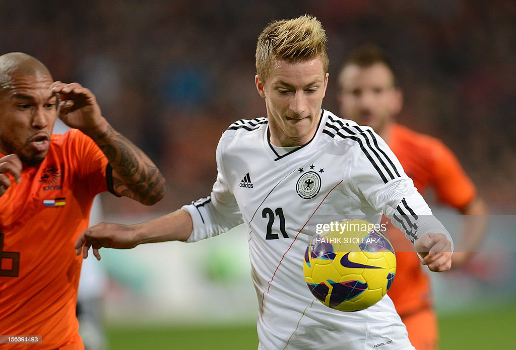 Dutch midfielder Nigel de Jong (L) vies with German midfielder Marco Reus (R) during the friendly football match Netherlands vs Germany on November 14, 2012 in Amsterdam.