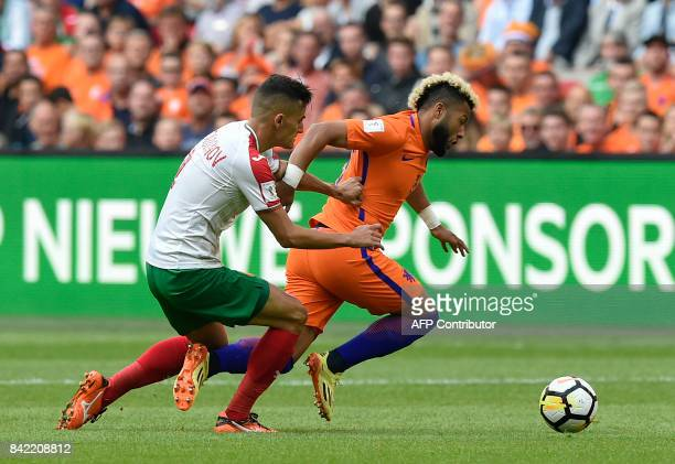 Dutch midfielder Tonny Vilhena outruns Bulgaria's forward Georgi Kostadinov during the FIFA World Cup 2018 qualification football match between The...