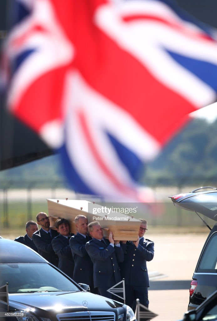 Dutch military personnel carry a coffin containing an unidentified body from the crash of Malaysia Airlines flight MH17 under a Union flag on July 23, 2014 in Eindhoven, Netherlands. Today the people of the Netherlands are holding a national day of mourning. Malaysian Airlines flight MH17 was travelling from Amsterdam to Kuala Lumpur when it crashed in eastern Ukraine killing all 298 passengers. The aircraft was allegedly shot down by a missile and investigations continue to find the perpetrators of the attack.