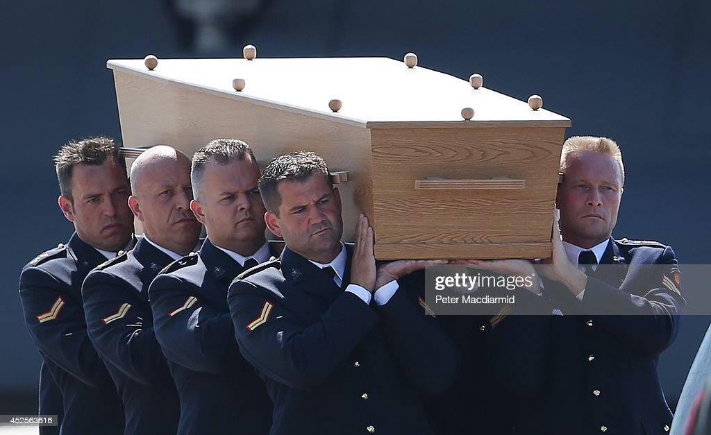 Dutch military personnel carry a coffin containing an unidentified body from the crash of Malaysia Airlines flight MH17 to a waiting hearse on July 23, 2014 at Eindhoven airport, Netherlands. Today the people of the Netherlands are holding a national day of mourning. Malaysian Airlines flight MH17 was travelling from Amsterdam to Kuala Lumpur when it crashed in eastern Ukraine killing all 298 passengers. The aircraft was allegedly shot down by a missile and investigations continue to find the perpetrators of the attack.