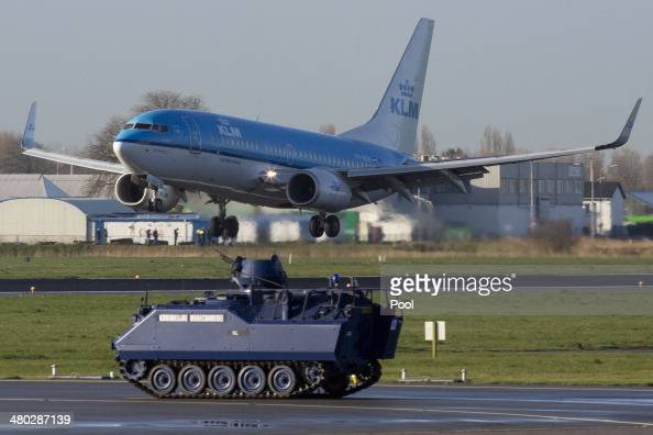 Dutch military police armored vehicle guards the runway prior to the arrival of US President Barack Obama at Schiphol Amsterdam Airport ahead of the...
