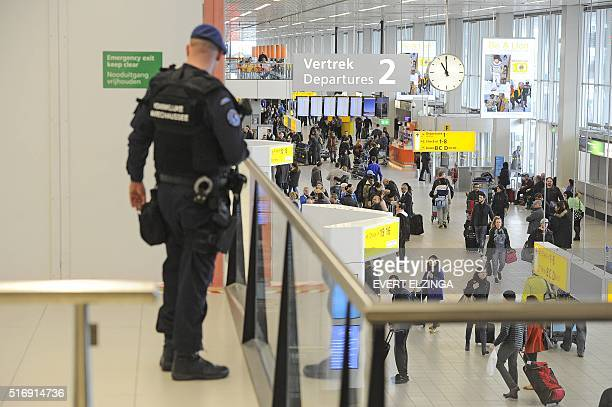 Dutch military police carries extra patrols at Schiphol Airport in Amsterdam on March 22 2016 The increased security comes in the wake of the...