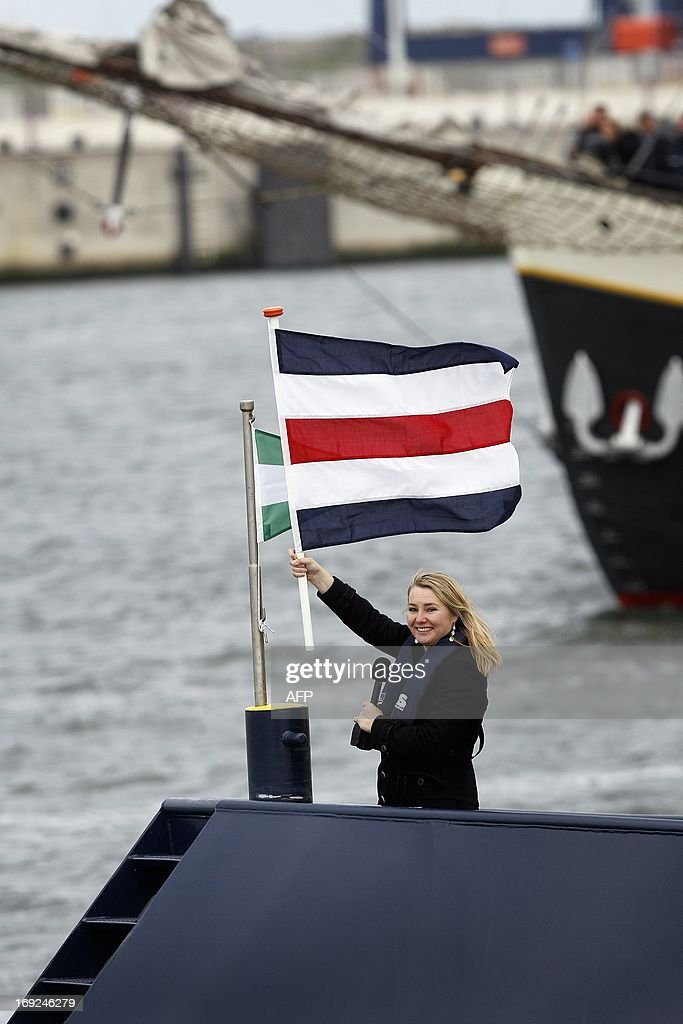 Dutch Minister of Infrastructure and Environment Melanie Schultz van Haegen waves a flag during the official opening of Maasvlakte 2 in the port of Rotterdam, on May 22, 2013. Europe's busiest port of Rotterdam opened a multi-billion euro extension on Wednesday, with wider and deeper basins to accomodate the world's biggest freight ships. The Maasvlakte 2 project is the largest feat of Dutch maritime engineering in decades, and will itself take another 20 years to reach capacity as world sea trade grows relentlessly and in spite of the economic crisis. AFP PHOTO / ANP / BAS CZERWINSKI