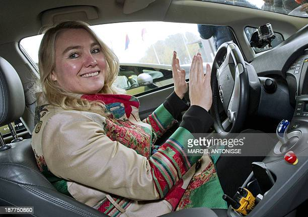 Dutch Minister of Infrastructure and Environment Melanie Schultz van Haegen sits in a selfdriving car on November 12 2013 The selfdriving car was...
