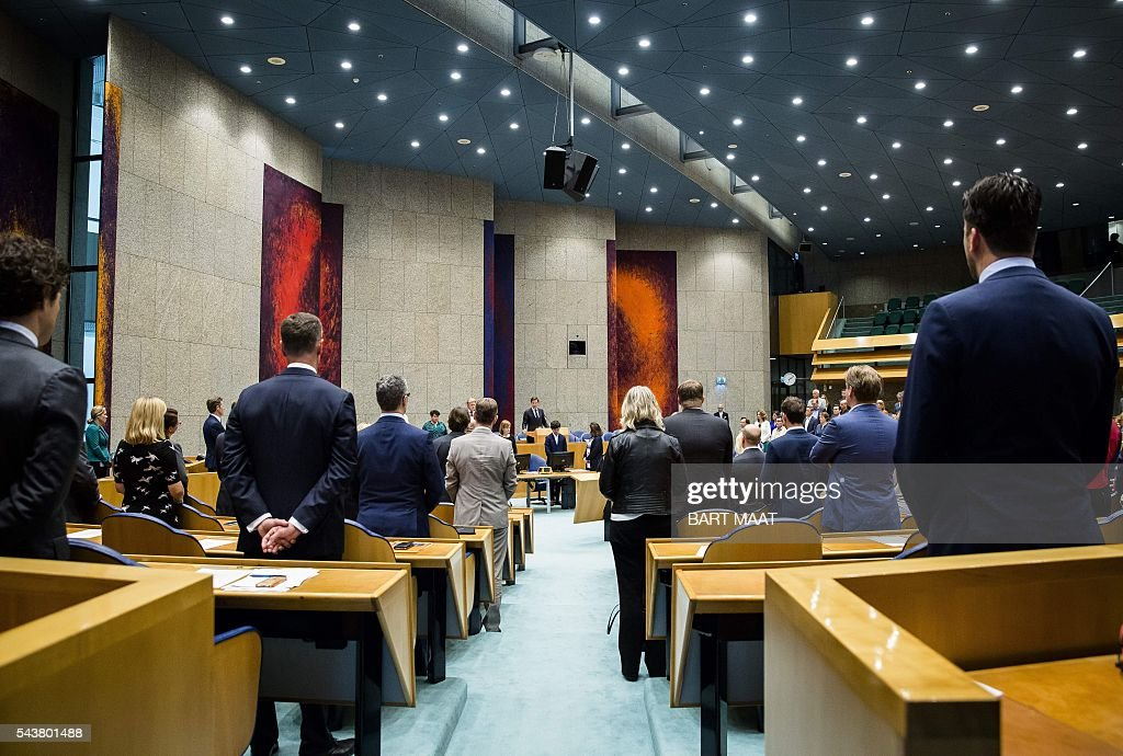 Dutch Ministers stands as they observe a minute of silence in memory of victims of the suicide attacks at the Istanbuls airport on 28 June, in the Second Chamber in The Hague on June 30, 2016. / AFP / ANP / Bart Maat / Netherlands OUT - Belgium OUT