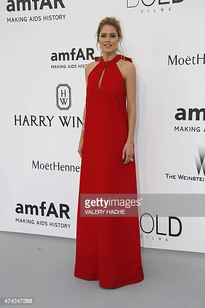 Dutch model Doutzen Kroes poses as she arrives for the amfAR 22st Annual Cinema Against AIDS during the 68th Cannes Film Festival at Hotel du...