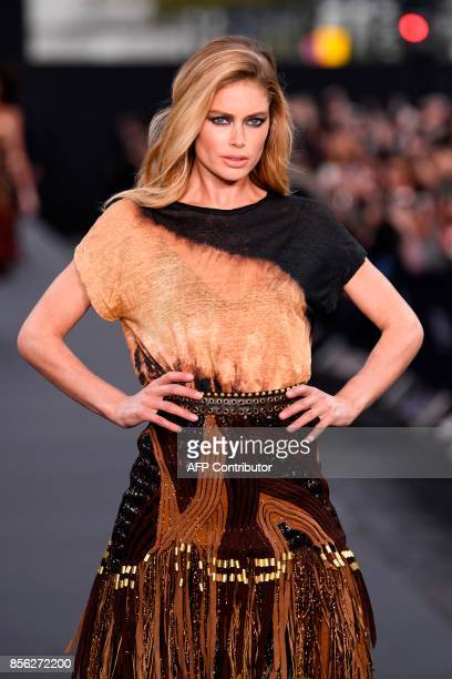 Dutch model Doutzen Kroes takes part in the L'Oreal fashion which theme is Paris on the sidelines of the Paris Fashion Week on October 1 on a catwalk...