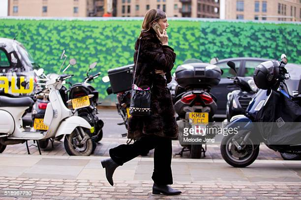 Dutch model Kiki Willems looks for her driver after the Mary Katrantzou show at 1 Granary Square during London Fashion Week Autumn/Winter 2016/17 on...
