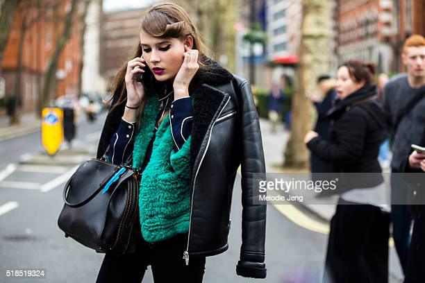 Dutch model Vera Van Erp makes a call after the Topshop Unique show at Tate Britain during London Fashion Week Autumn/Winter 2016/17 on February 21...