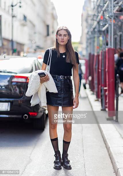 Dutch model Vera van Erp wearing a black leather skirt tshirt boots with socks on September 28 2016 in Paris France