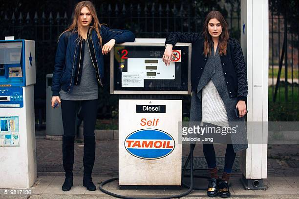Dutch models Annika Krijt and Vera Van Erp pose with a Tamoil Diesel selfpump after the Tod's show at Padiglione d'Arte Contemporanea during the...