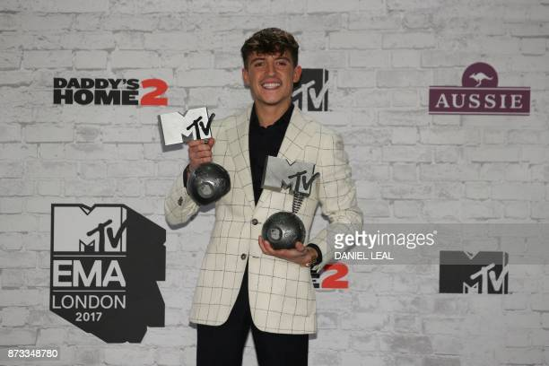 Dutch musician Lil' Kleine poses with his awards for best Dutch act and best worldwide act during the 2017 MTV Europe Music Awards at Wembley Arena...