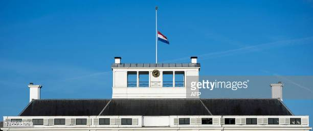 A Dutch national flag flies on halfmast on the Soestdijk palace in Baarn The Netherlands on August 16 2013 Dutch Prince Friso of The Netherlands will...
