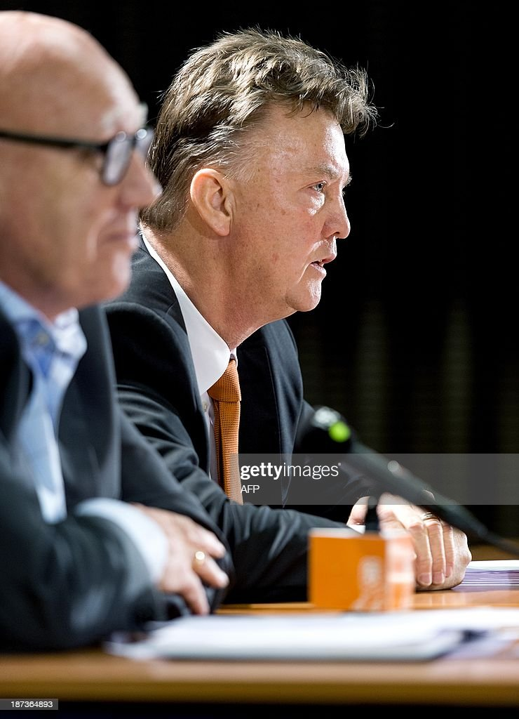 Dutch national football team head coach Louis Van Gaal (R) and press chief Kees Jansma deliver a press conference in the KNVB Sports Centre in Zeist,on November 8, 2013. The coach announced the final selection of Dutch team prior to the international football matches against Japan on November 16 and against Colombia on November 2013. AFP PHOTO ANP KOEN VAN WEEL - Netherlands out - Belgium out