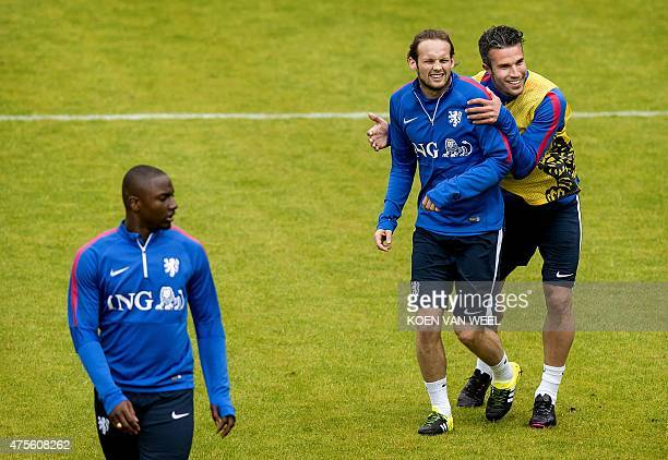 Dutch National football team players Daley Blind jokes with Robin van Persie during a training session in Hoenderloo on June 2 three days ahead of a...