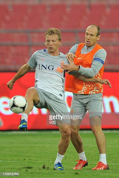 Dutch national football team players Dirk Kuyt and Arjen Robben attend a training session at Workers' Stadium on June 10 2013 in Beijing China