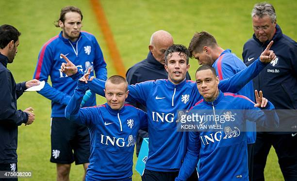 Dutch National football team players Jordy Clasie Robin van Persie and Gregory van der Wiel are pictured during a training session in Hoenderloo on...