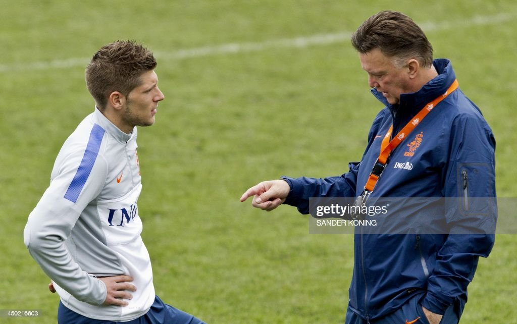 Dutch national football team's coach Louis van Gaal (R) gives intruction to Stijn Schaars as they take part in a training session in Katwijk, on November 17, 2013, in preparation of the international match against Colombia on November 19.