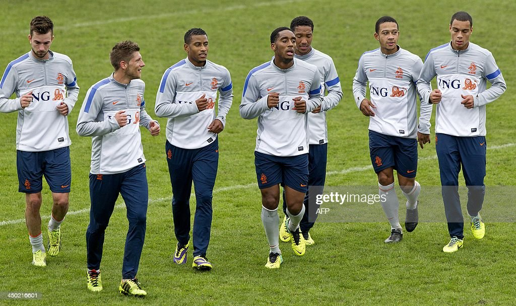 Dutch national football team's players Davey Propper, Stijn Schaars, Luciano Narsingh, Jonathan de Guzman, Leroy Fer, Memphis Depay and Gregory van der Wiel take part in a training session in Katwijk, on November 17, 2013, in preparation of their international match against Colombia on November 19.