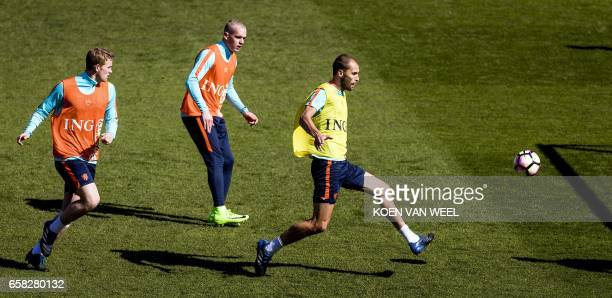 Dutch national players Matthijs de Ligt Rick Karsdorp and Bas Dost practice during a training session ahead of the friendly football match Netherland...