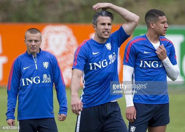 Dutch national soccer team players Jordie Clasie Robin van Persie and Jeffrey Bruma attend a training session in Hoenderloo on June 3 2015 The Dutch...