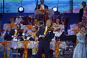 Dutch orchestra leader Andre Rieu directs a concert on the Museumplein Square given on the occasion of the investiture of the country's new King...