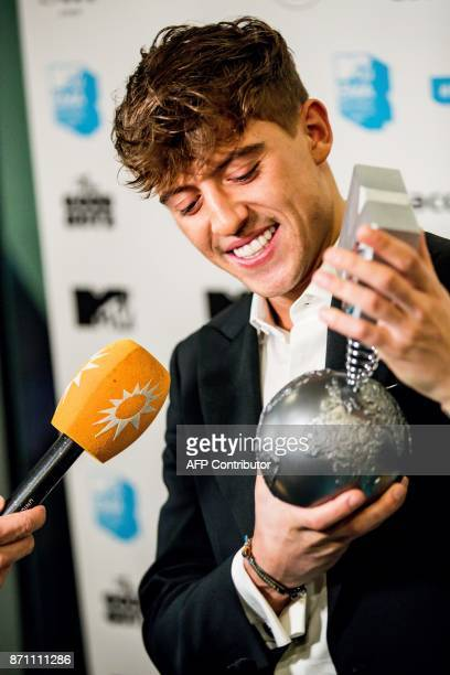 Dutch perfomer Lil' Kleine receives the MTV European Music award for best Dutch act during the EMA preparty in Amsterdam on November 6 2017 / AFP...