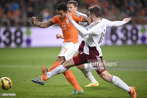 Dutch player Memphis Depay vies with Latvia's Aleksandrs Fertovs during the Euro 2016 qualifying round football match between the Netherlands and...