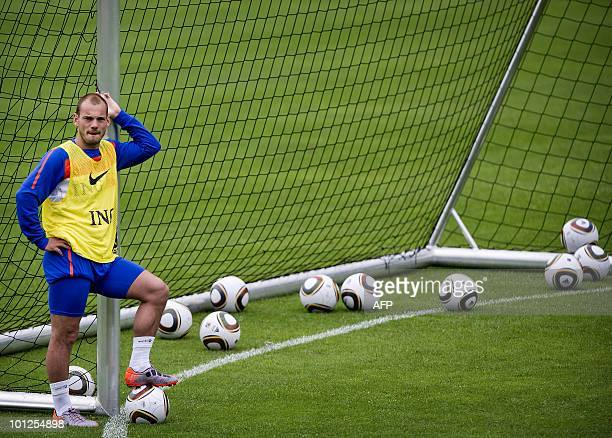 Dutch player Wesley Sneijder leans against a goal post during a training session of the Dutch national team in Seefeld Austria on May 29 2010 The...