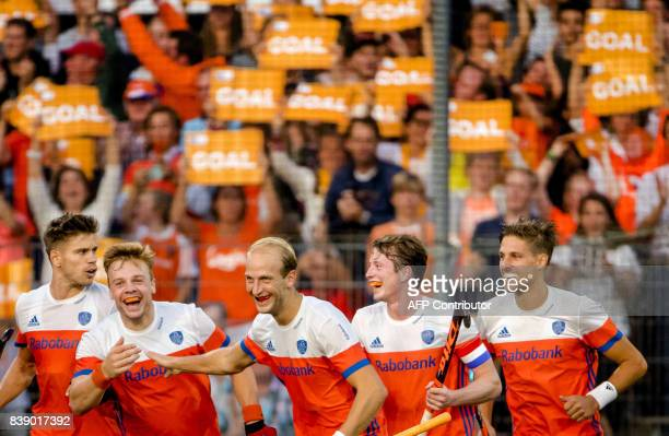 Dutch players celebrate after scoring during the men's hockey semifinal match Netherlands v England at The Rabo EuroHockey Championships 2017 in...