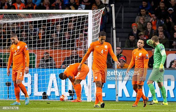 Dutch players react after Czech Republic scored during the Euro 2016 qualifying football match between the Netherlands and Czech Republic in...