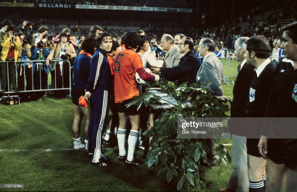 Dutch players shake hands with officials after the FIFA 75th Anniversary match between Holland and Argentina at the Wankdorf Stadium in Bern...
