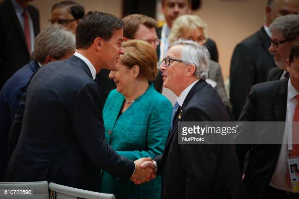 Dutch PM Mark Rutte shakes hands with European Commission president JeanClaude Juncker ahead of the plenary session at the G20 summit on 8 July 2017...