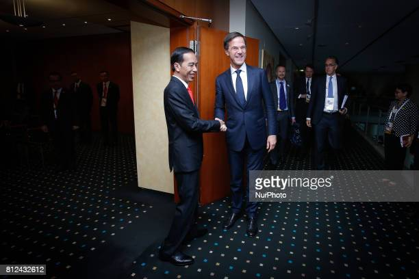 Dutch PM Mark Rutte shakes hands with Indonesian president Joko Widodo at the Steinberger hotel during the G20 summit in Hamburg Germany on 8 July...