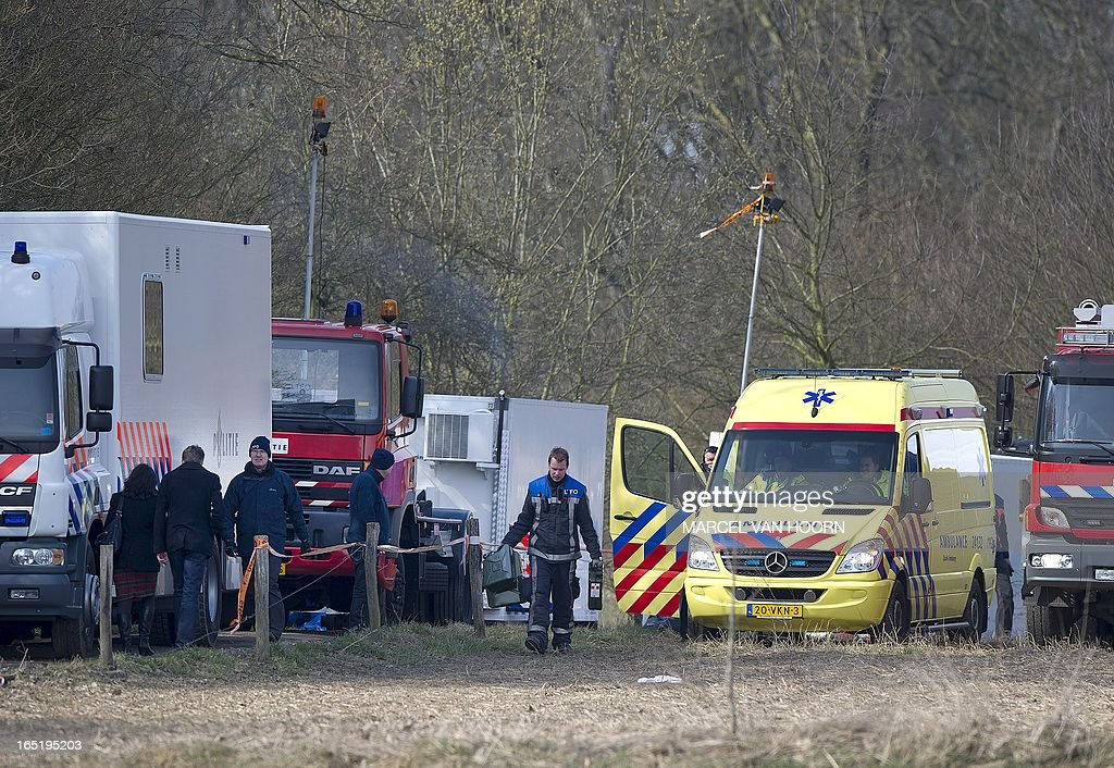 Dutch police and chemical weapons experts search for a suspected stockpile of deadly sarin gas outside the popular tourist city of Maastricht, on April 1, 2013. Police cordoned off an area in a forest just outside the southern city but found nothing, public prosecutor spokeswoman Cindy Rijnders told AFP. Police received a tip-off on March 27 and arrested a Dutch man and woman on March 31 night at the scene when they allegedly started digging for the hidden deadly nerve gas. Two other people, also Dutch nationals, were arrested in the nearby town of Heerlen, Rijnders said.