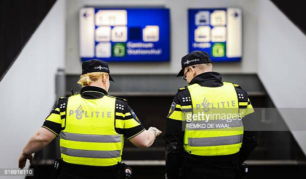 Dutch police officers patrol the Central Station in Amsterdam on March 22 2016 as security measures were reinforced in the wake of blasts in Brussels...