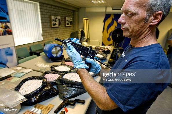 Dutch police show a cache of seized drugs and weapons in The Hague on July 16 2009 Six arrests were made in relation to the haul which included...