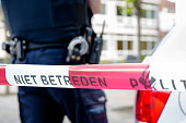 Amsterdam Netherlands 16th June. Police officer behind Red plastic tape after an incident at school
