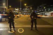 Dutch policemen stand guard by a cordoned off area outside Amsterdam's Schiphol Airport late on April 12 after it was partially evacuated following a...