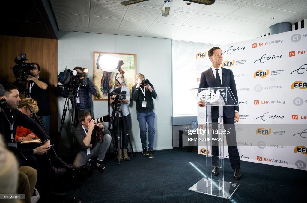 Dutch Prime Minister and leader of the People's Party for Freedom and Democracy (Volkspartij voor Vrijheid en Democratie - VVD) Mark Rutte (R) speaks during a press conference on March 13, 2017 at Erasmus University in Rotterdam. Dutch Prime Minister Mark Rutte faces a major challenge from the far-right in general elections on March 15, 2017. Twenty-eight parties and 1,114 candidates, the highest number since World War II, will compete in the Dutch elections, chasing 150 seats in the lower house of parliament. / AFP PHOTO / ANP / Remko de Waal / Netherlands OUT