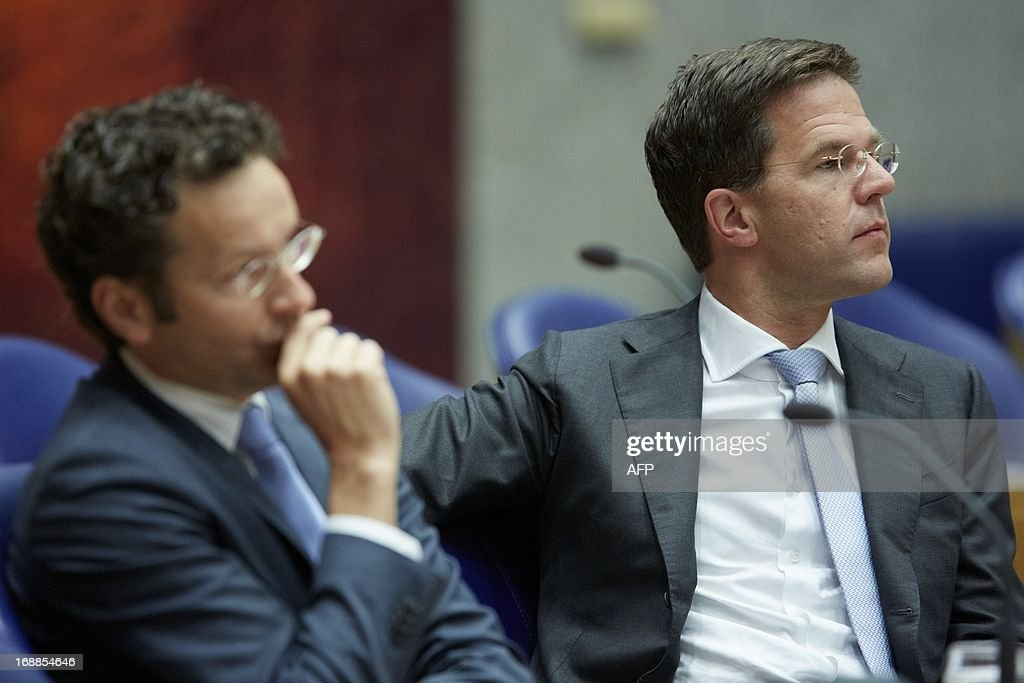Dutch Prime Minister Mark Rutte (R) and Dutch Minister of Finance Jeroen Dijsselbloem (L) listen during a debate about financial balance at the Dutch House of Representatives in the Hague on May 16, 2013.