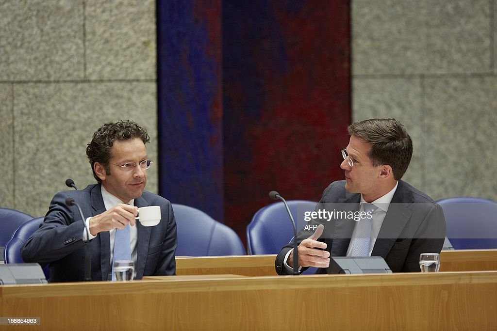Dutch Prime Minister Mark Rutte (R) and Dutch Minister of Finance Jeroen Dijsselbloem (L) attend a debate about financial balance at the Dutch House of Representatives in the Hague on May 16, 2013. AFP PHOTO / ANP / MARTIJN BEEKMAN