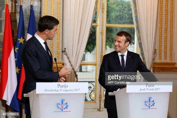 Dutch Prime Minister Mark Rutte and French President Emmanuel Macron give a joint press conference following a meeting at the Elysee palace on August...