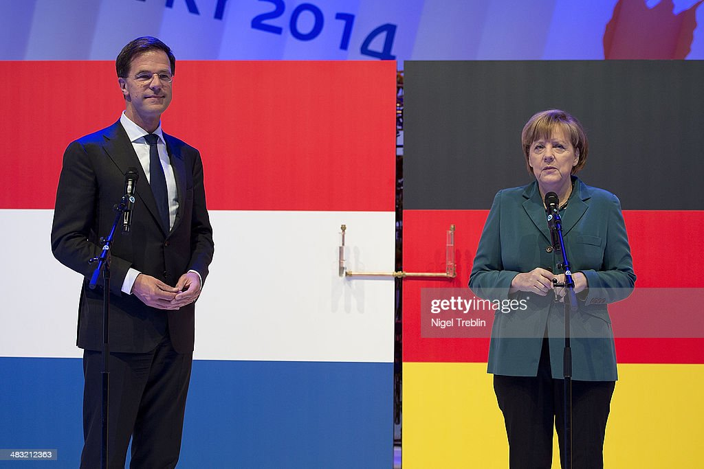 Dutch Prime Minister <a gi-track='captionPersonalityLinkClicked' href=/galleries/search?phrase=Mark+Rutte&family=editorial&specificpeople=4509362 ng-click='$event.stopPropagation()'>Mark Rutte</a> and German Chancellor <a gi-track='captionPersonalityLinkClicked' href=/galleries/search?phrase=Angela+Merkel&family=editorial&specificpeople=202161 ng-click='$event.stopPropagation()'>Angela Merkel</a> attend The Hannover Messe industrial trade fair on April 7, 2014 in Hanover, Germany. The Netherlands is the official partner Country of this year's fair with more than 5000 companies showcasing their latest industrial products and solutions. The Hannover Fair will run from April 07-11.