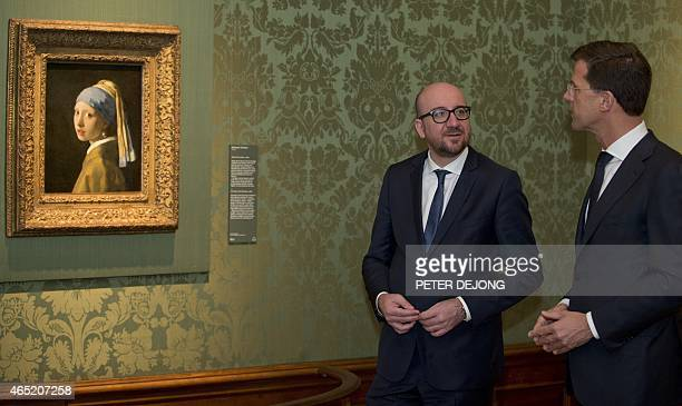 Dutch Prime Minister Mark Rutte and his Belgian counterpart Charles Michel pose next to Vermeer's 'Girl with a Pearl Earring' at Mauritshuis museum...